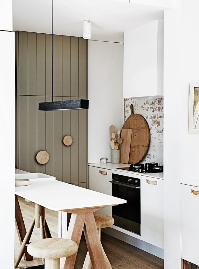 Bucking the trend of 'bigger is better,' this slim, understated white and timber island bench adds functionality and understated style to this [Edwardian home's](http://www.homestolove.com.au/creative-restoration-of-an-old-edwardian-house-5316) kitchen.