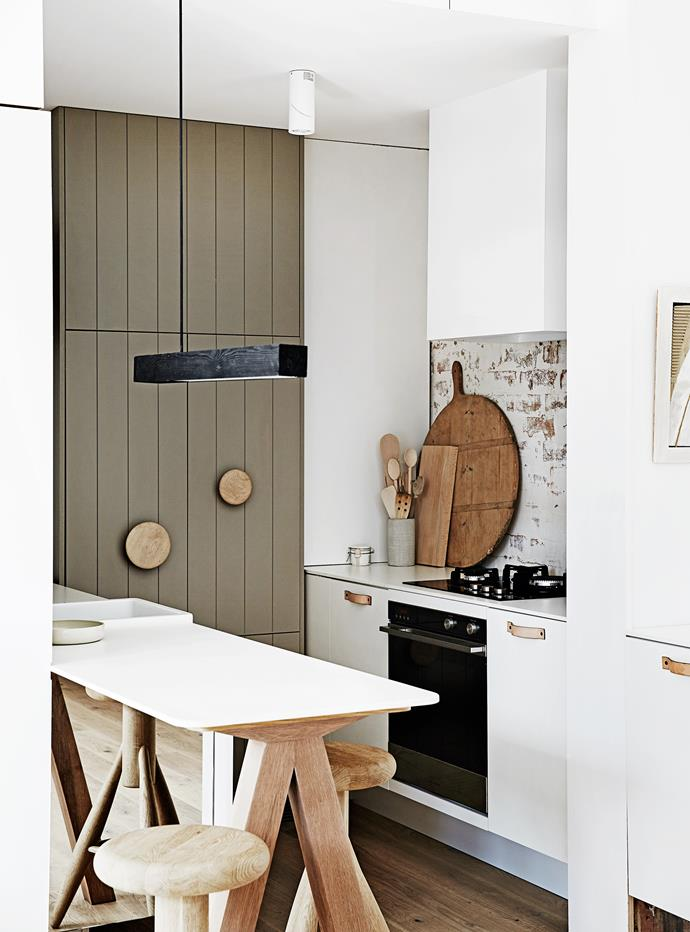 """Carole chose to forgo a large island bench in the kitchen and go for something more discreet and personal. """"I hate overhead cupboards, so I don't have any,"""" she adds."""