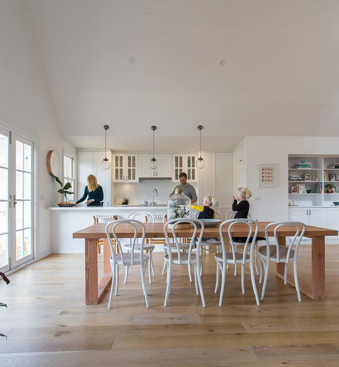 Emily's **white kitchen** features wood tones and interesting accessories, such as the lovely stools.