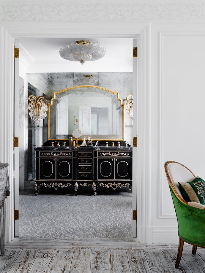 In the master ensuite is a custom vanity by Adam Hart. Mirror from Dering Hall. French 1940s crystal and gilt chandelier and Baguès Art Deco sconces, all from Newel NY. Stone and concrete flooring by Euro Marble.