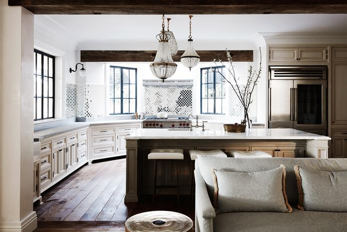 Antique French and Austrian chandeliers in the kitchen. Stools from Thomas Hayes Gallery LA.