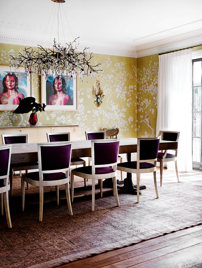 Formal dining room has de Gournay wallpaper from Milgate. Gregorius Pineo chairs from Kneedler Fauchère. Oak and iron table from Bie Baert Belgium. Kate Moss triptych by Chris Levine. Serip chandelier. Behruz rug.
