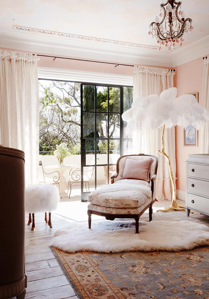 In a child's bedroom is a late 19th-century French polychrome duchesse brisée from C Mariani Antiques San Francisco. Aynhoe Park Collection Hollywood Regency ostrich feather floor lamp. Restoration Hardware chest. Cadrys rug. Sheepskin from NSW Leather Co.