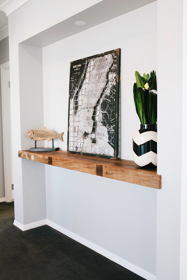 """When building their [classic style family home in Brisbane](https://www.homestolove.com.au/classic-style-new-build-in-brisbane-5370 target=""""_blank""""), owner Julie furnished the home on a budget of $15, 000. Upcycling was one of their budgeting solutions. The timber for this sturdy shelf, for example, was sourced from an old water tower. *Photo:* Josette van Zutphen"""