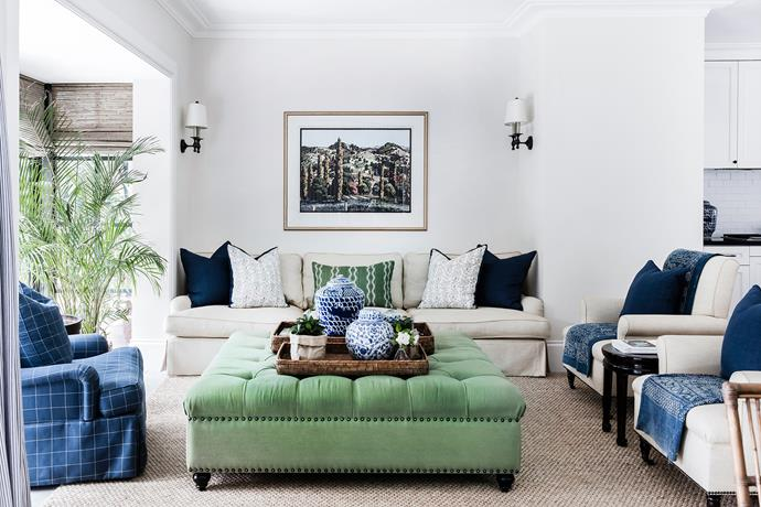 Select tones of green enhance the room's direct outlook to the garden. Interior designer Lynda Kerry designed the sofas, ottoman, chairs, cushion and throws in a well-curated range of designer and vintage textiles.