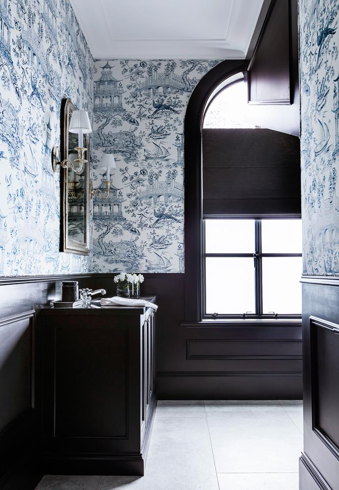 Even the relatively modest powder room received the couture treatment, with the upper walls covered in Giverny Mandolin fabric from Unique Fabrics.
