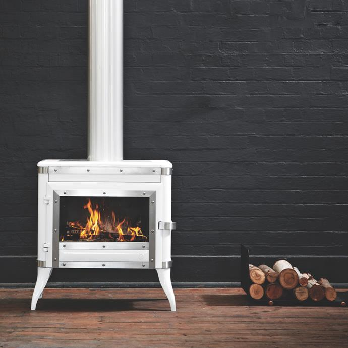 Evoking memories of colonial times, Oblica's 'Tennessee' freestanding enamel-finished fireplace, $5200, resembles wood stoves used in pioneers' huts. [www.oblica.com.au](https://oblica.com.au/)