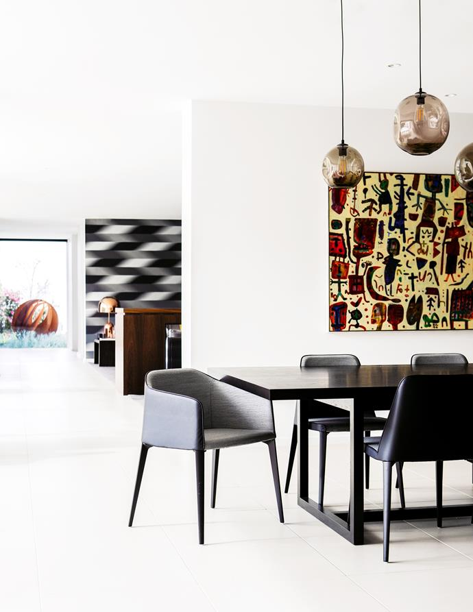 The dining table was custom made by Alexander J Cook. Dining chairs from James Richardson. Pendant lights by Mark Douglass Design. Artwork by David Larwill.
