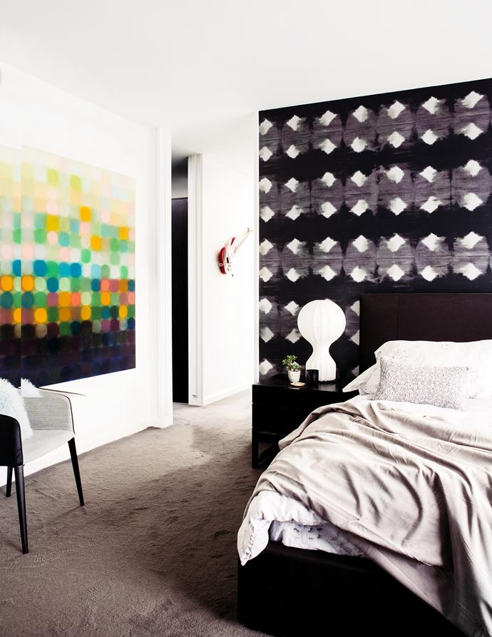 The main bedroom features a patterned wallpaper from France. Flos 'Gatto' table lamp by the bedside.