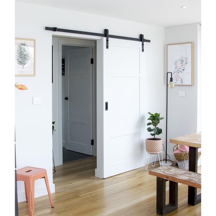 We love this industrial-vibe barn door from Bunnings. The Lockwood two-metre Outland barn door track hardware kit is just $149.