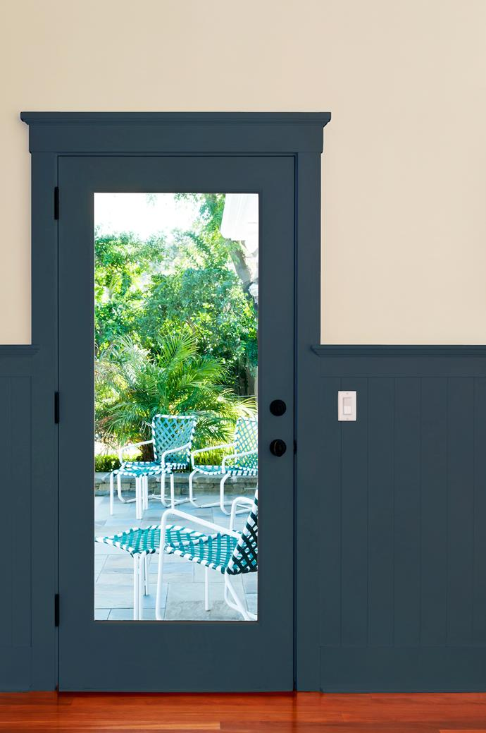 Matching doorframe, skirting and panelling. Tick. The paint draws the eye to the mid-line of the walls.