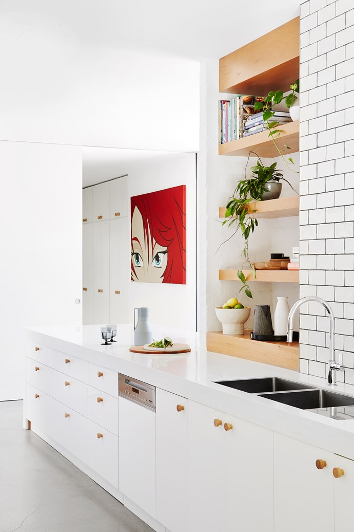 """""""We loved the idea of leather cabinet pulls in the kitchen but timber knobs were far cheaper and look just as smart,"""" says Andrea."""