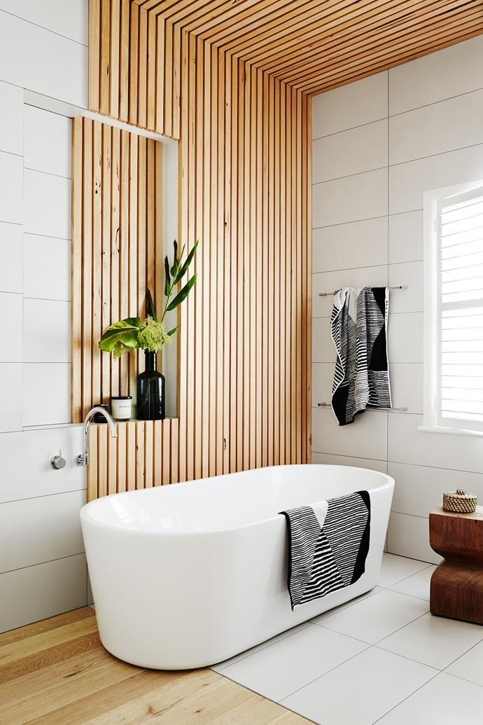 """""""We used the Tasmanian-oak battens to define the bath area and bring warmth to the room,"""" says Sarah."""