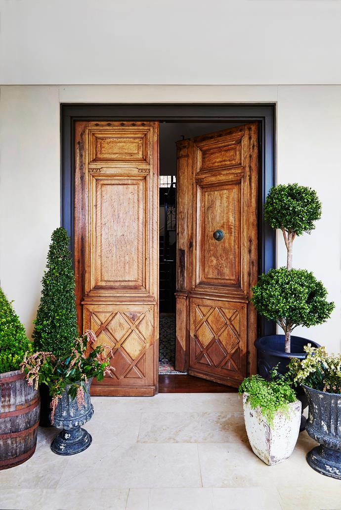 The stunning antique doors, imported from Spain, make a bold style statement.