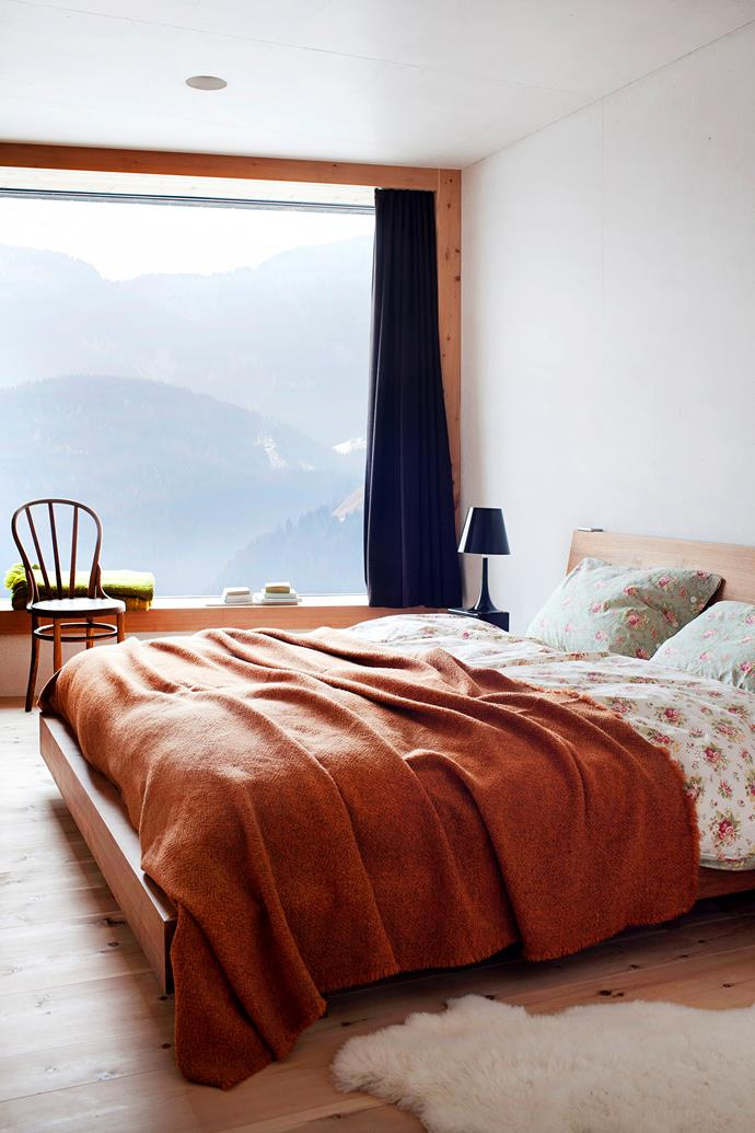 The master bedroom is all about that view. Armin designed the bed and the orange bedspread is by Society.