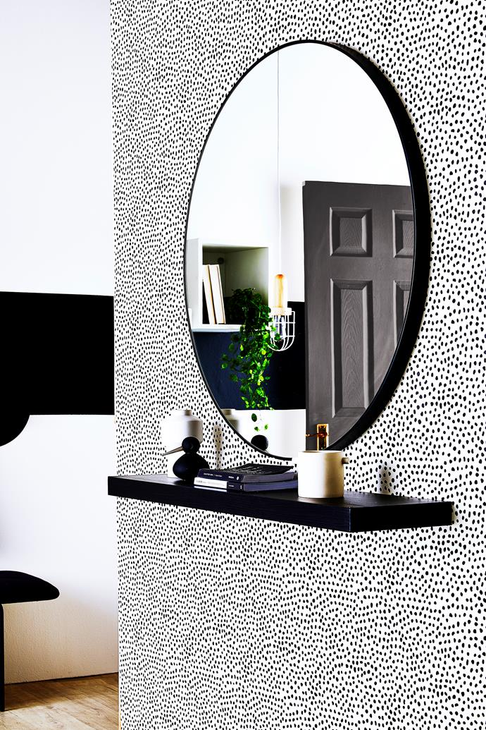 Get a glimpse of yourself on the way out with a mirror positioned near the door.