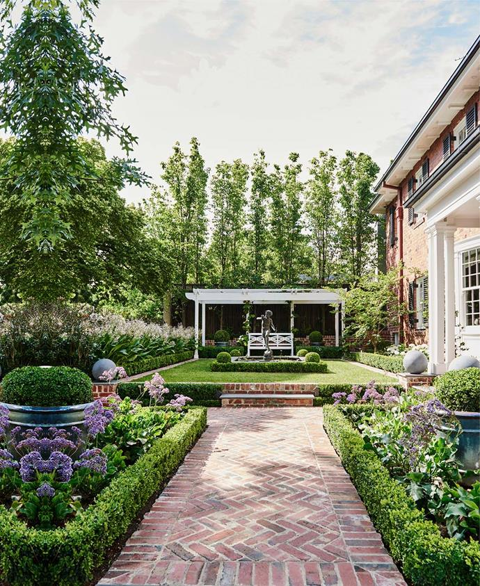 Manicured gardens courtesy of landscape designer Jenny Smith surround this 1930s Gregorian Melbourne home by Stuart Rattle and Adelaide Bragg. *Photograph*: by Lisa Cohen. From *Belle* June/July 2017.