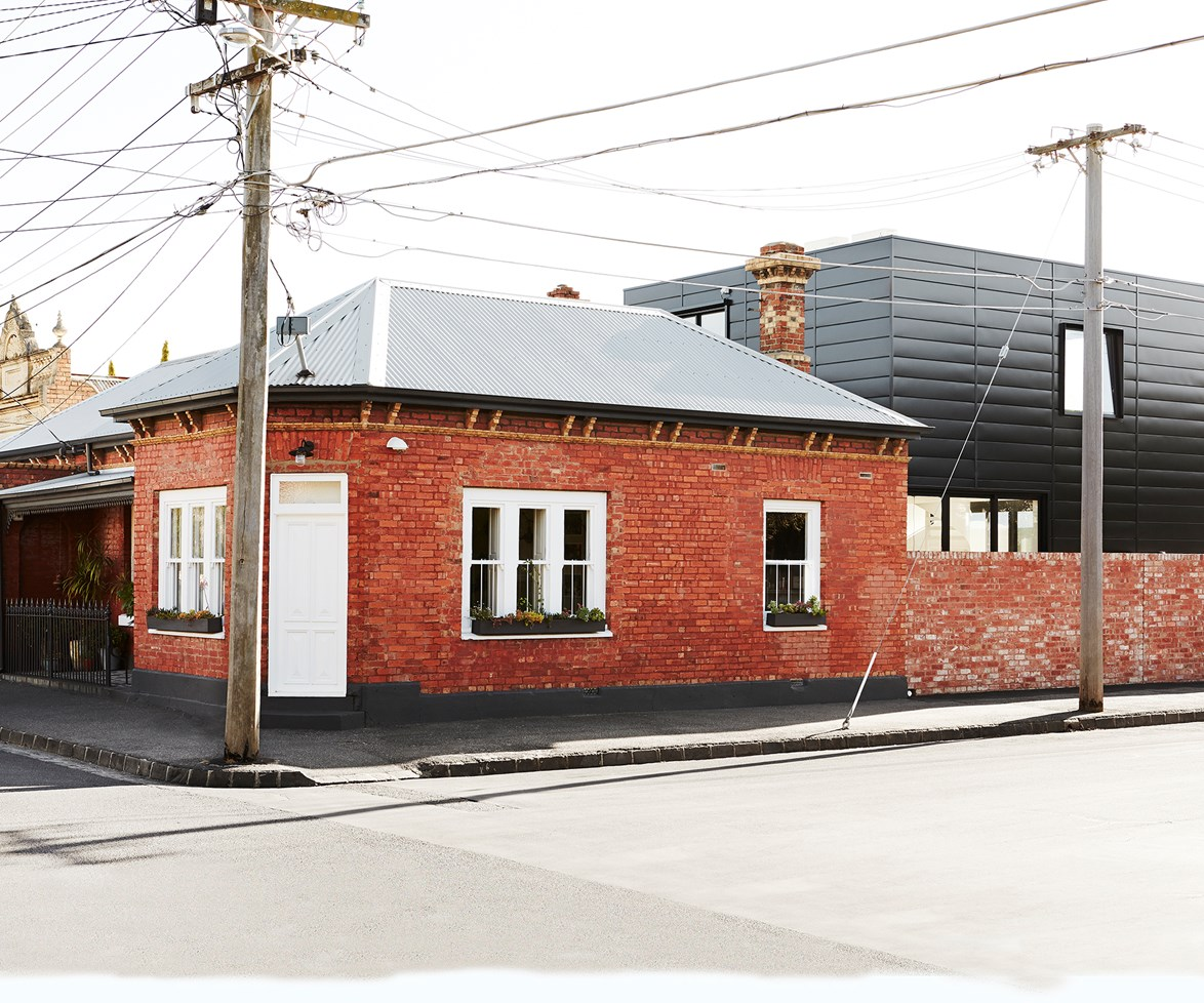 "This [19th-century corner shop](https://www.homestolove.com.au/modern-extension-added-to-historic-melbourne-corner-shop-5474|target=""_blank"") looks like it has been frozen in time, until you notice the sleek Colorbond-clad extension protruding from the rear. Enchanted by the building's history, the owners decided to restore the red-brick façade and connect a contemporary dwelling to increase their living space without compromising the building's integrity. Photo: Anette O'Brien / *Australian House & Garden*"