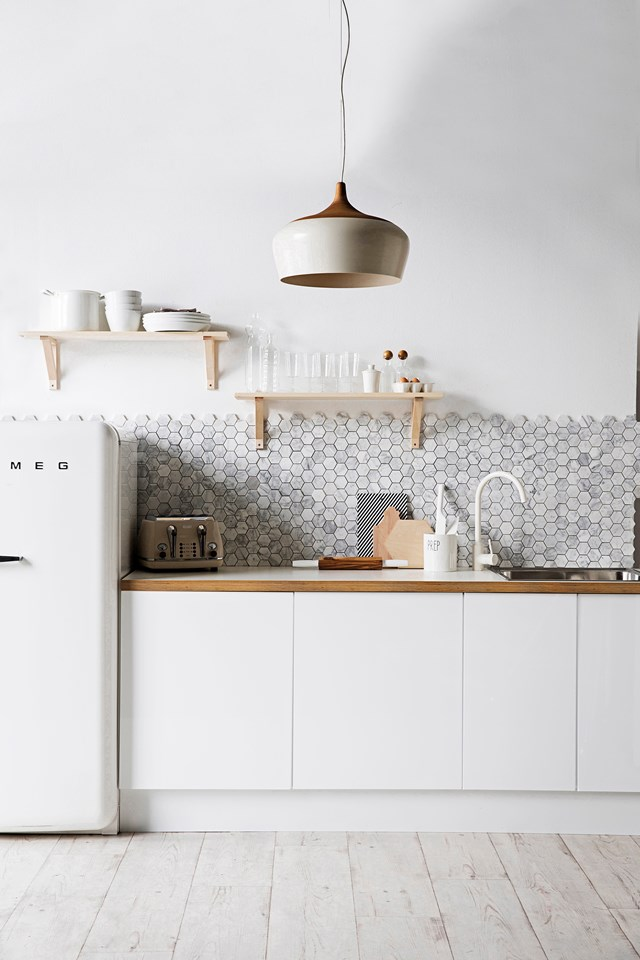 When tiling a small area like a splashback, you can afford to spend a bit more on tiles to get a luxe look.