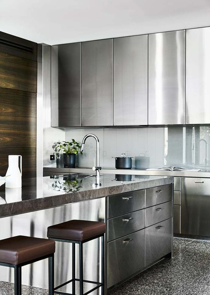 Stainless steel on the cabinetry and rear benchtop helps reflect light around the room.