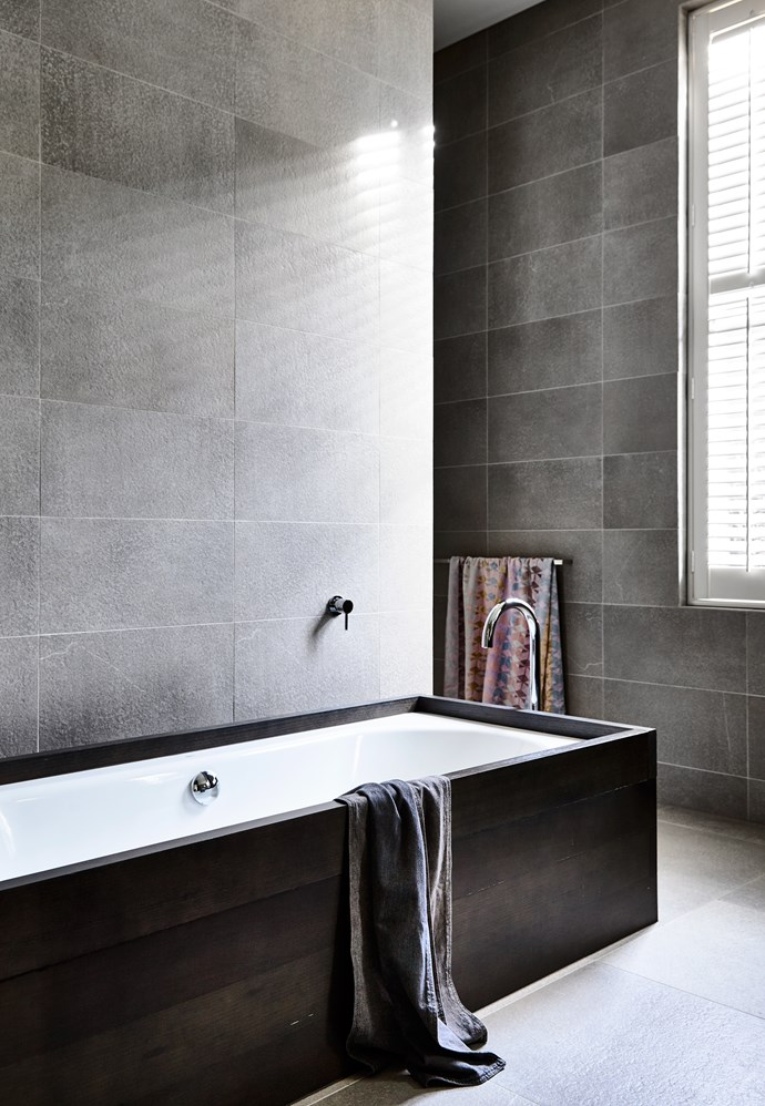 A custom-made smoked-eucalypt bath surround ties in with the joinery in the kitchen.