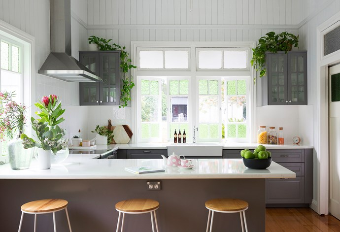 Ikea Bodbyn cabinets and a marble-look laminate benchtop create a modern country-style kitchen.