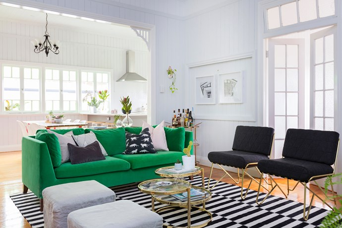The bright and airy open-plan living-dining space is Katie's favourite. The statement green velvet sofa is from Ikea.
