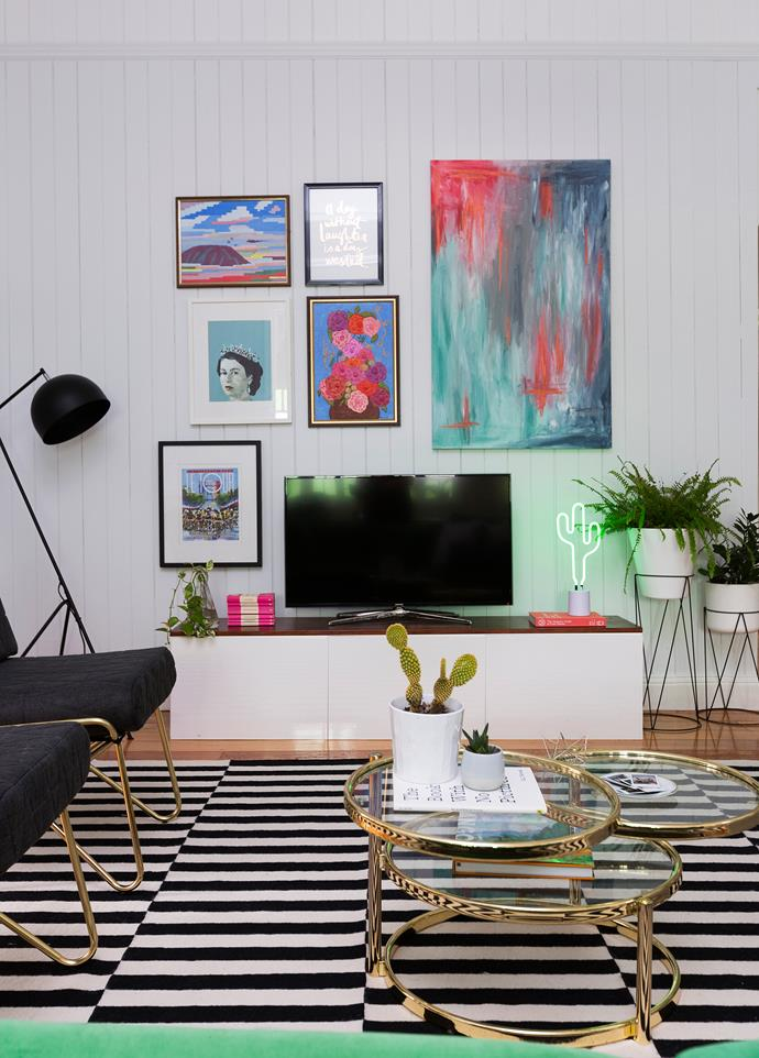 This gallery wall was created to disguise the TV and highlight the tall ceilings. Katie painted the abstract canvas.