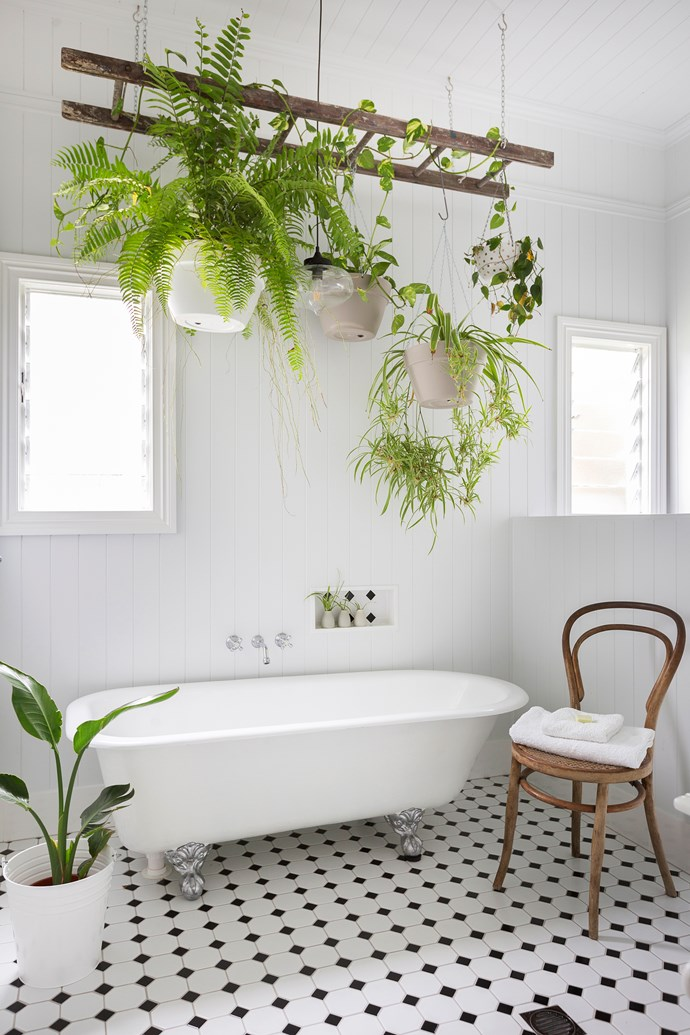 """An original """"rust bucket"""" cast-iron tub was restored by professionals for the main bathroom."""