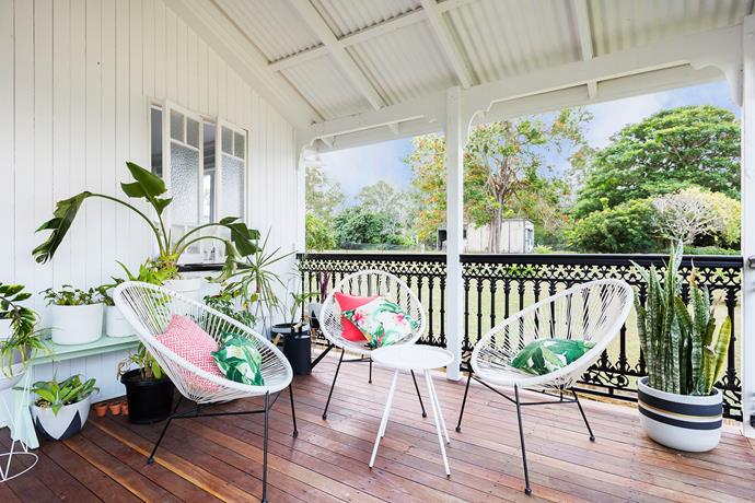 The master bedroom opens out onto the front verandah. Chairs from Kmart.