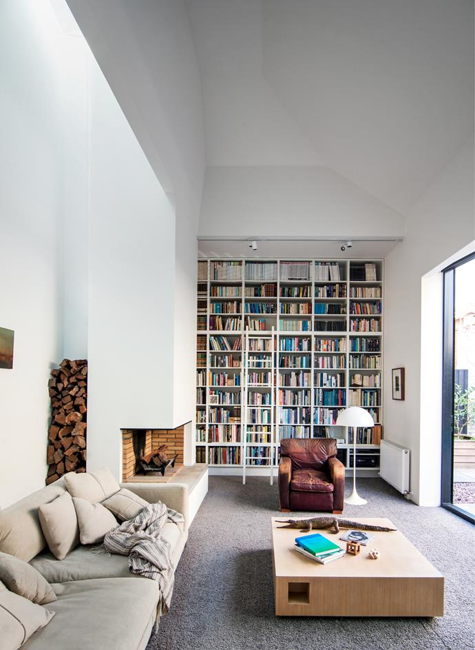 A wall of books sets the tone for quiet time in the library which doubles as a parents' retreat in this Melbourne home by Coy Yiontis Architects and Rosa Coy. *Photograph*: Michael Wee. From *Belle* February/March 2016.