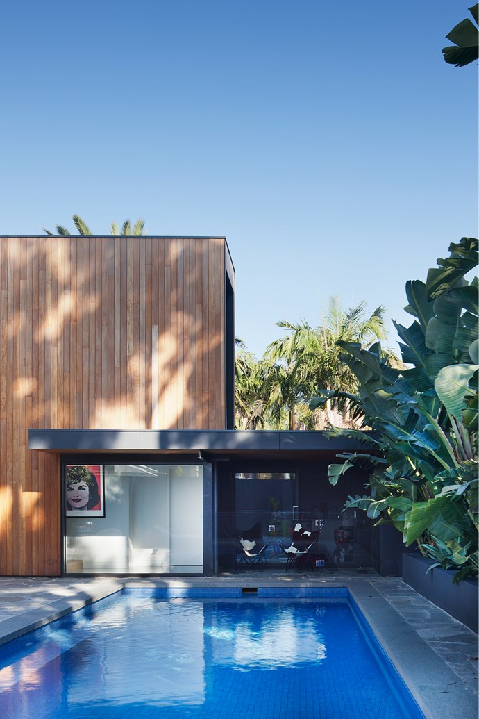 The pool and back terrace of this Melbourne home by Bower Architecture and Interiors and LBA Construction Group are connected directly with the house via a floor-to-ceiling glass door. *Photograph*: Shannon McGrath. From *Belle* May 2016.