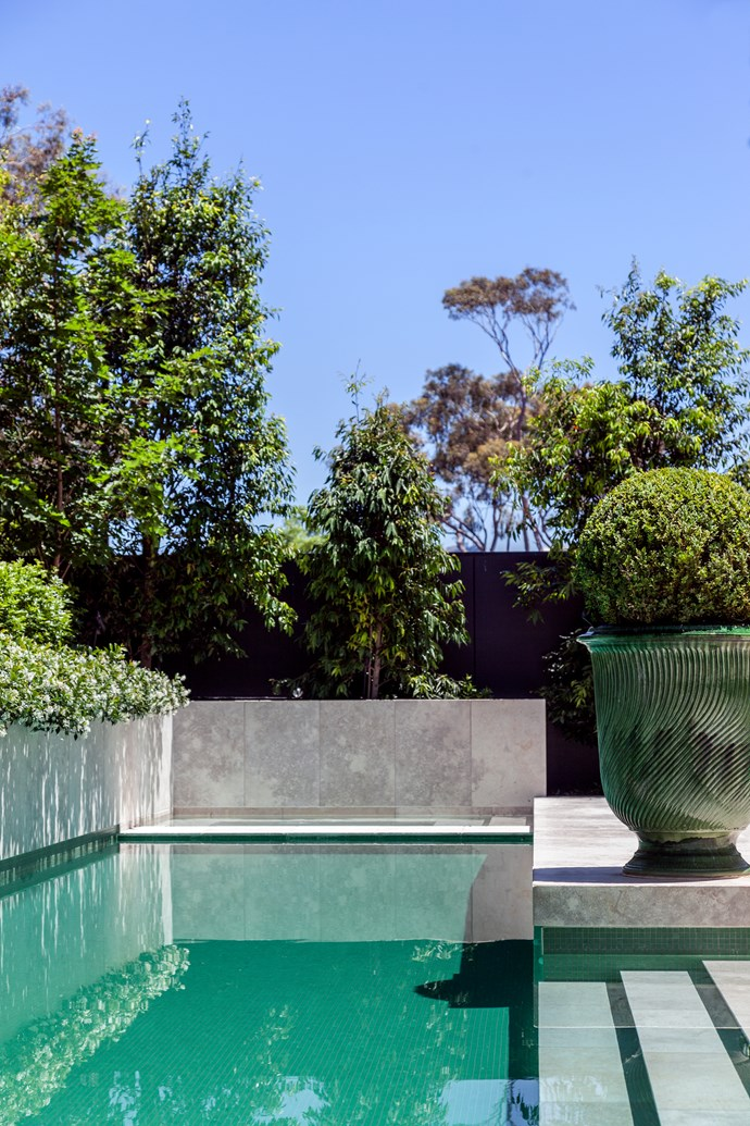 Jasmine spills over the pool's limestone wall. For year-round good looks, landscaper Paul Bangay designed the garden in a restrained green palette. Melbourne home by Russell Casper. *Photograph*: Matt Lowden. From *Belle* December/January 2016