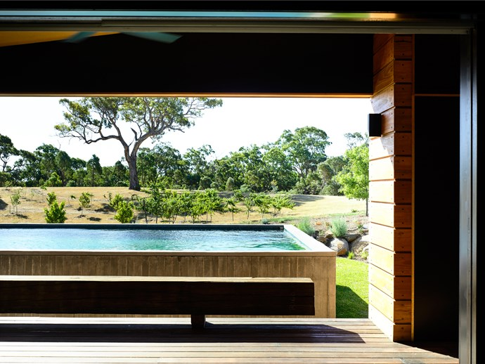 A beautiful panorama of the Metcalfe range just outside of Melbourne can be enjoyed from this natural pool designed by Architects and owners Jerry Wolveridge and Christina Theodorou. *Photograph*: Derek Swalwell. From *Belle* June/July 2017.