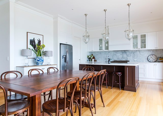 Statement glass pendants, shaker style cabinetry and marble finishes - this kitchen is the epitome of classic Hamptons style. Photo: Katherine Jamison / *homes+*