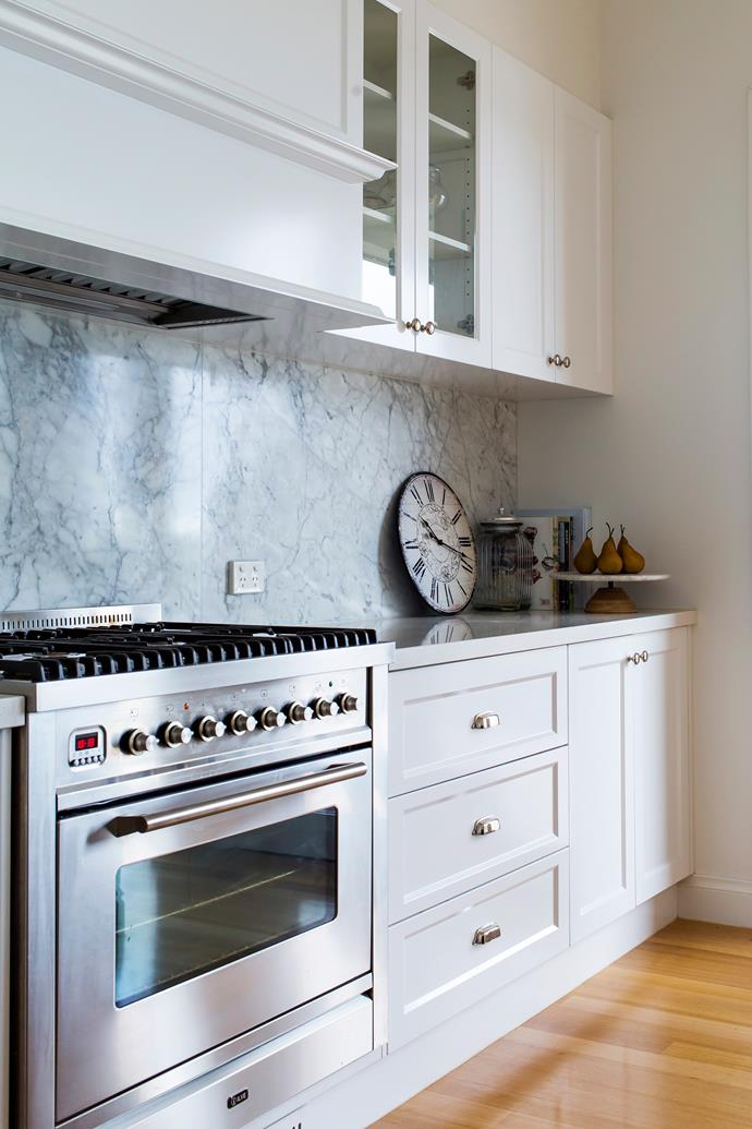 A few glass-fronted cabinets allows for display of Louise's kitchenware.