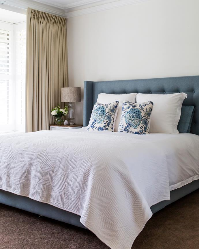 The cushions – which are repeated in the living room – tie in beautifully with the king bed from Forty Winks.