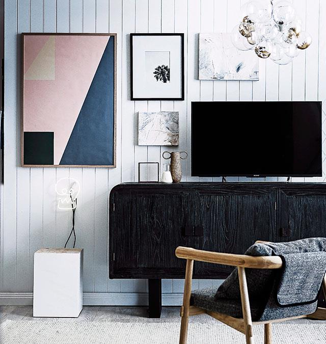 Get arty and use frames creatively around your TV to make it less of a focal point. *Photo: Maree Homer / bauersyndication.com.au*