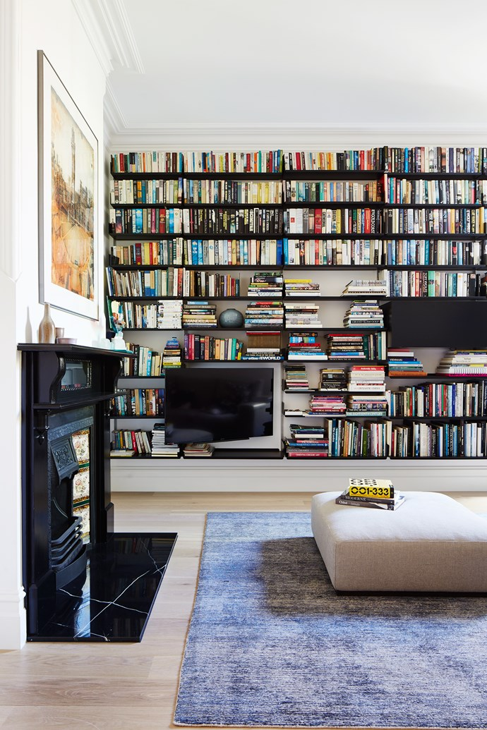 A wall of books creates an atmosphere of dignified calm.