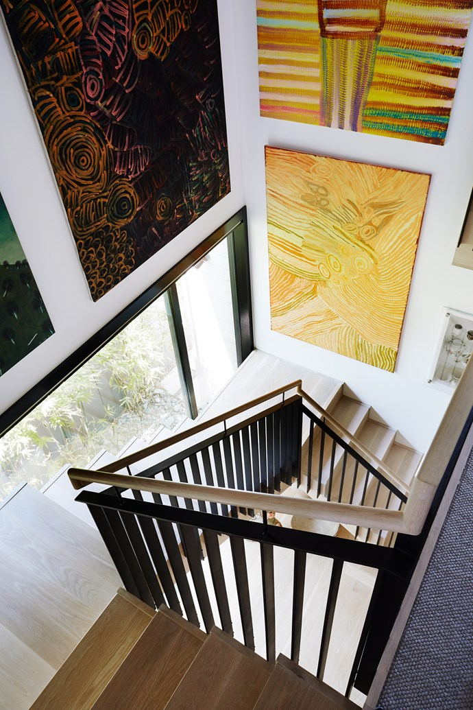 Negotiating the stairs is a regular exercise in art appreciation, as one passes paintings by Minne Pwerle (left), Makini Napanangka and others at close range.