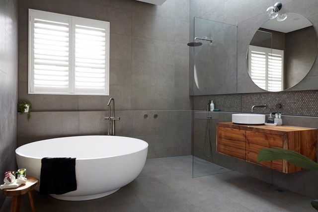 """**The Block 2017: Josh and Elyse** Who could forget Josh and Elyse's zen bathroom from the Elsternwick series of The Block? Not us! That round bathtub totally won us over and also [won Josh and Elyse first place](https://www.homestolove.com.au/josh-elyse-house-the-block-5917