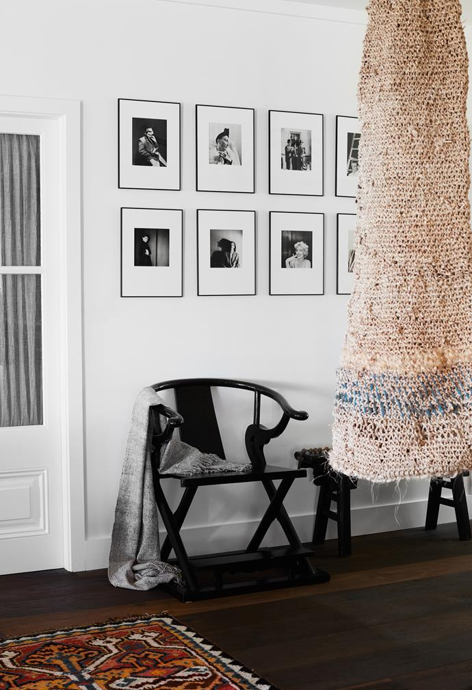 In the bedroom is a woven work by Brooke Munro, antique Chinese chair and bench, and framed Hollywood stars of the 1940s. Throws by Mariella Ienna. Artwork by Salim.