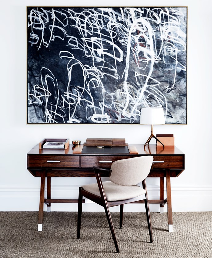 A relaxed and sophisticated study designed by Peter Stewart exudes a mid-century aesthetic. The BassamFellows 'Soft Series' desk accessories are from Living Edge on a Henning Jensen & Torben Valeur desk. Kai Kristiansen '#42' chair from Great Dane Furniture. *Shark Fin Soup* artwork by Guy Maestri. *Photograph*: David Wheeler. From *Belle* June/July 2016.