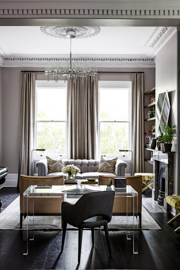 Interior designer Brendan Wong finessed this 1890s home into a modern gem. Lucite desk with a custom glass top by Brendan Wong. *Photograph*: Maree Homer. From *Belle* June/July 2015.
