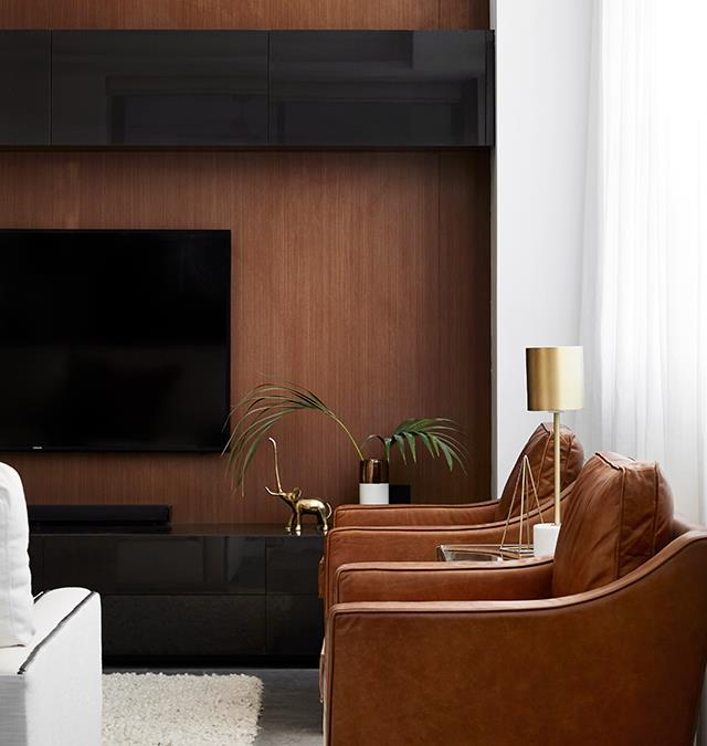 Keep your TV space as empty as possible to ensure the screen remains the room's visual priority. *Photography: Tess Kelly / bauersyndication.com.au*