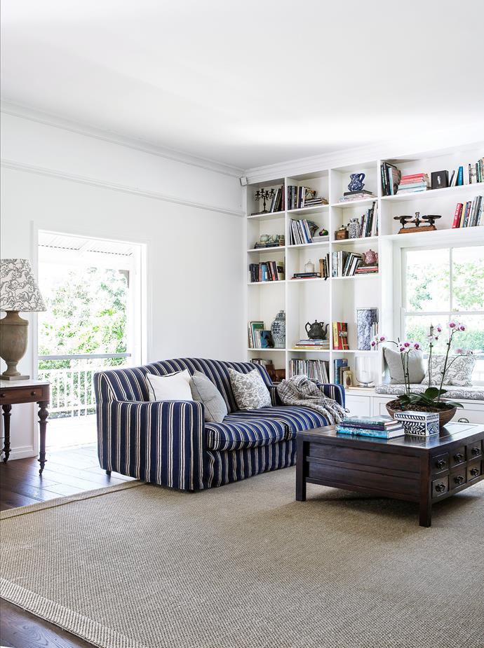 Ralph Lauren fabric on the lampshade and blue-patterned furnishings dotted throughout give this room a sophisticated country feel. Sofas with slipcovers, cushions, lamp and sisal rug, from Black & Spiro.