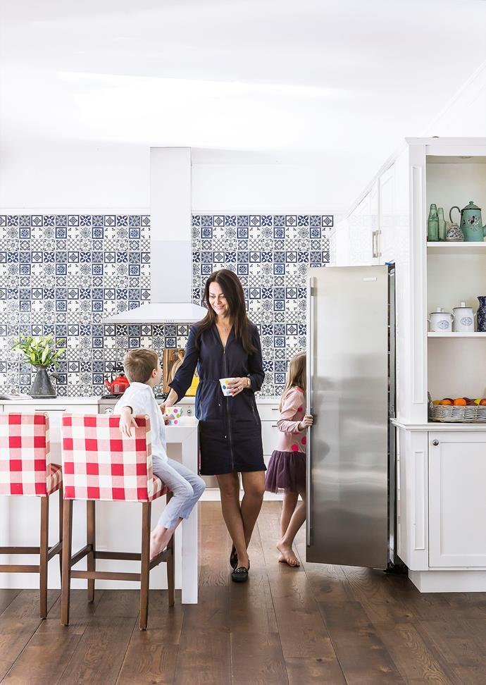 """All the tiles and oak flooring are new,"" says Juliette of the classic/contemporary space. The proximity of the fridge to the bench gives Hudson and Sara easy access. Smart buy: Old World Classics tiles, $98.55/set of nine, from Complete Tiles & Stone."