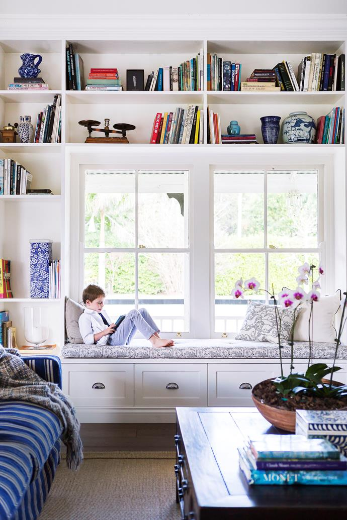 "Hudson at the centre of the book-friendly cabinetry with a Shaker profile specified by his mother Juliette, who opted for more storage in her 16-drawer coffee table from Myer. ""It's wonderful,"" she says. ""We have games, toys and also my nail polish in there."""