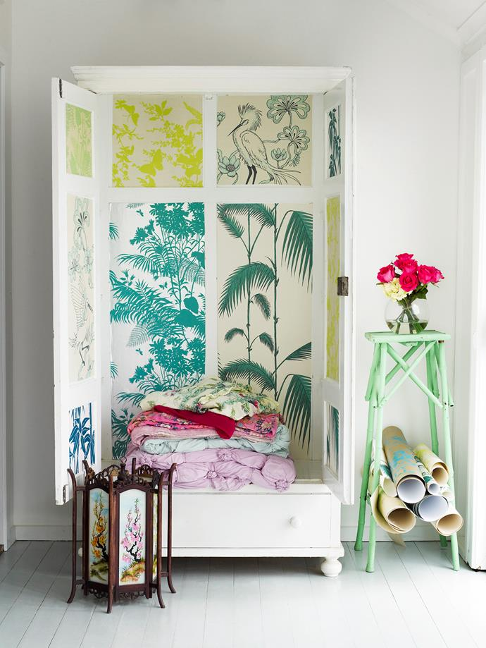 This old cupboard is given new life with a patchwork of wallpaper.