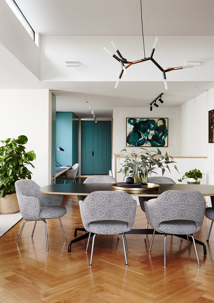 Eames segmented dining table, Luke Furniture. The Eero Saarinen 'Executive' chairs were bought in the US and reupholstered in Mokum 'Tribe' fabric. **Artwork** by Loretta Smith.